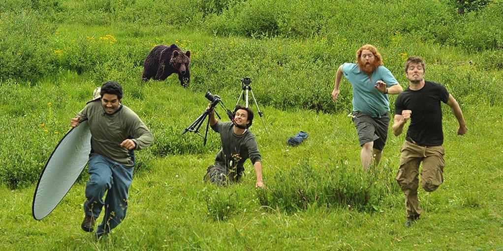 image of people fleeing bear